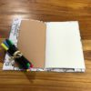 petit cahier coloriage dinosaures ouvert